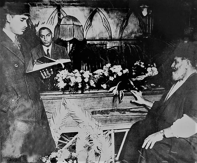 Maulana Shaukat Ali sitting next to the coffin of his brother Maulana Muhammad Ali Jauhar Courtesy Lahore Museum Archives